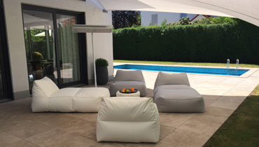 MOONICH Lounge: white armchairs and sofas under sun protection by the pool